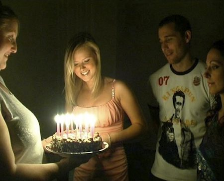 Party time for Ellie's Mum (Sally Reeve), Ellie (Sasha Jackson)  and Mark (Travis Oliver) as Ellie prepares to blow out the candles